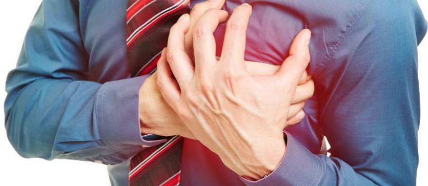 man in suit clutching heart